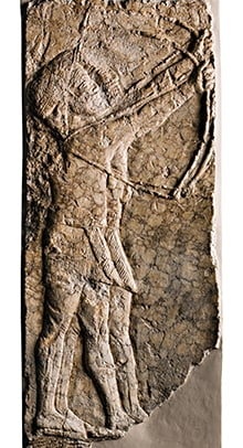 Limestone carving of two Assyrian archers