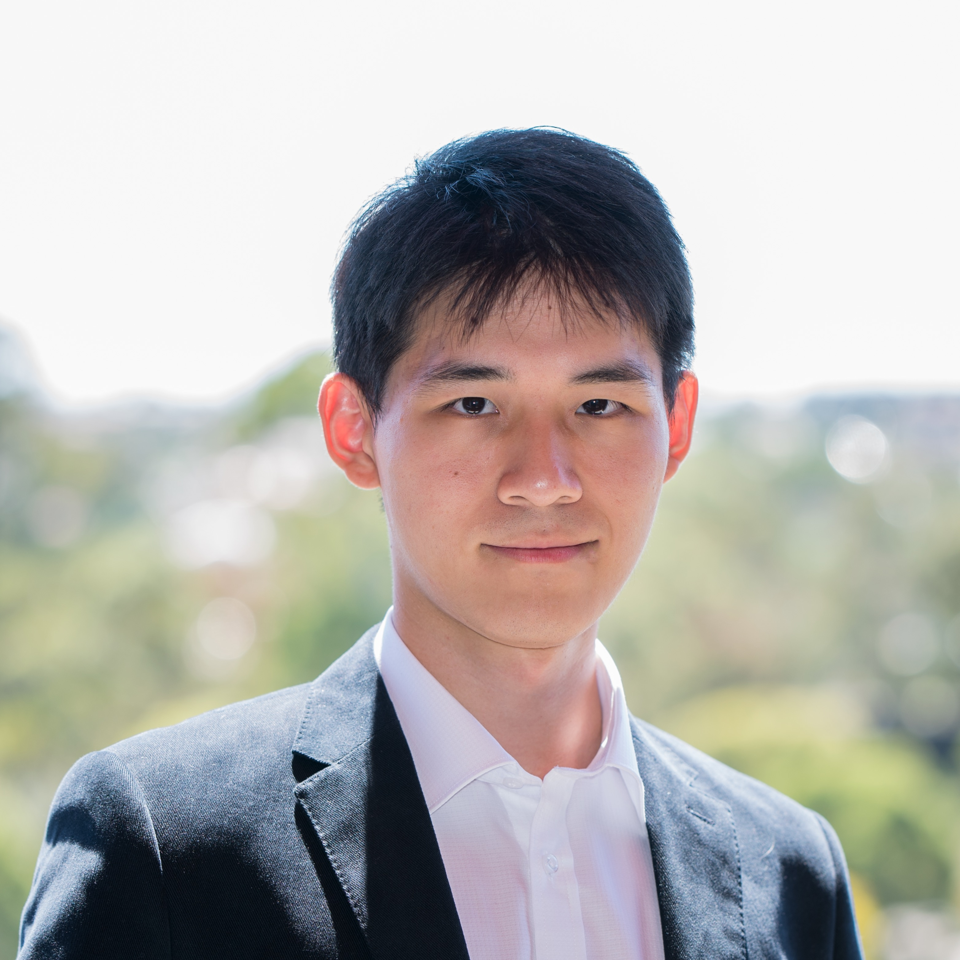 Professional headshot of Elevn Li
