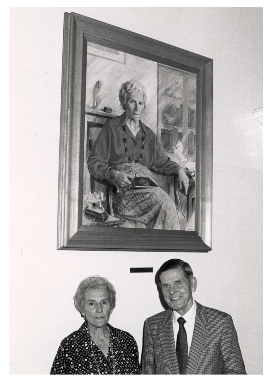 Ann Macintosh with artist Stuart Maxwell and the portrait he painted of her