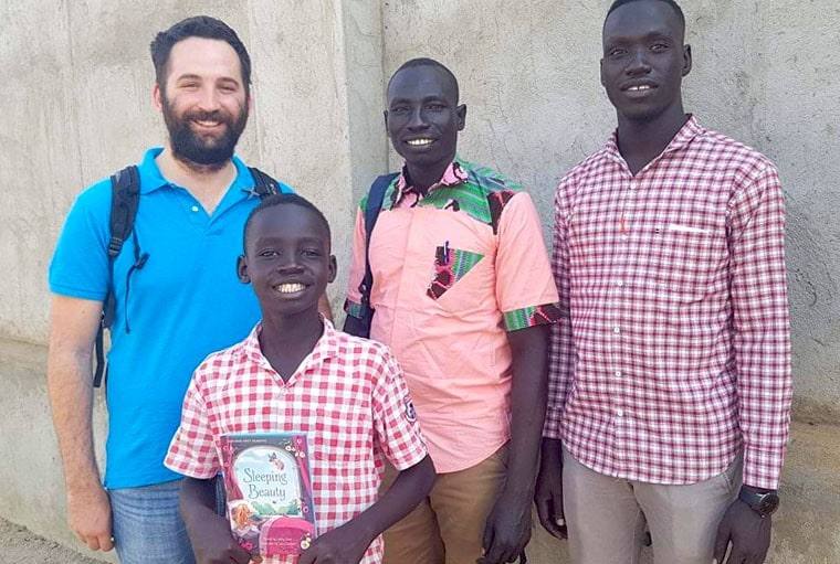 Kevin Lenahan in front of South Sudan Library
