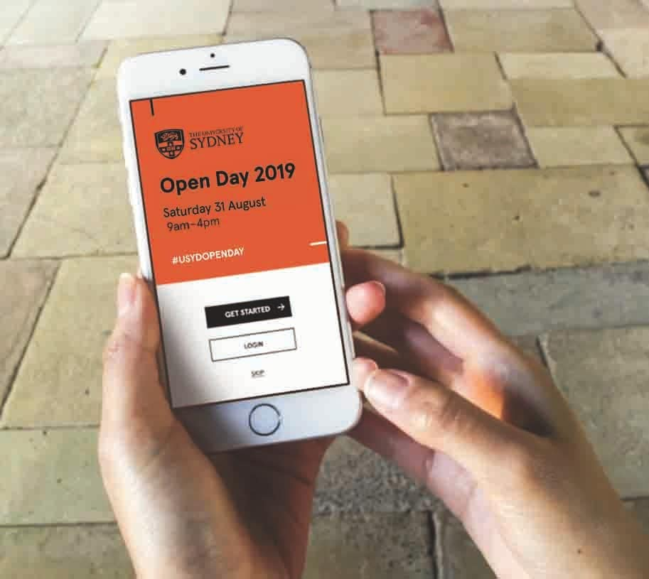 Hand holding a mobile phone with screen displaying the Open Day app