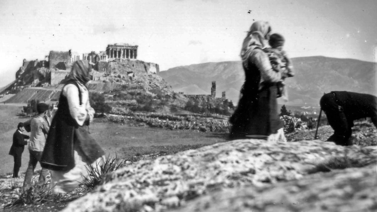 Black and white photograph of Greek countryside by William J Woodhouse, with the Acropolis in the distance.