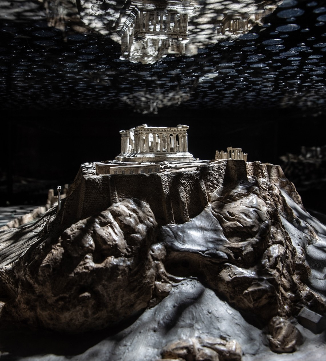 Model of the Acropolis of Athens bathed in darkness and speckled light
