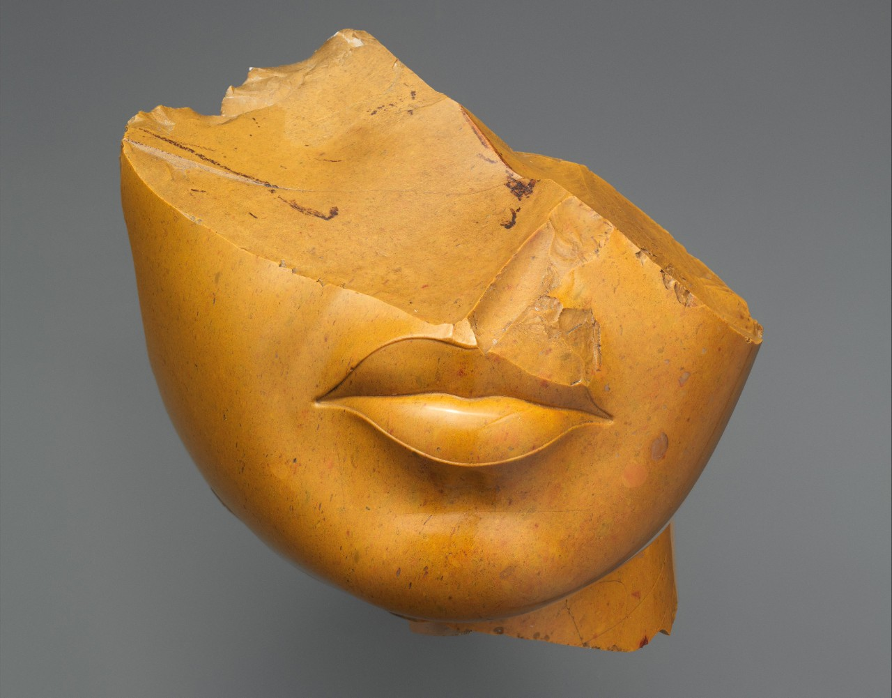 Broken sculpture of a woman's face