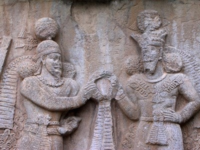 Ardishir receives the 'ring of kingship' from the god Ahura. Relief from Taq-i Bistun, Iran.