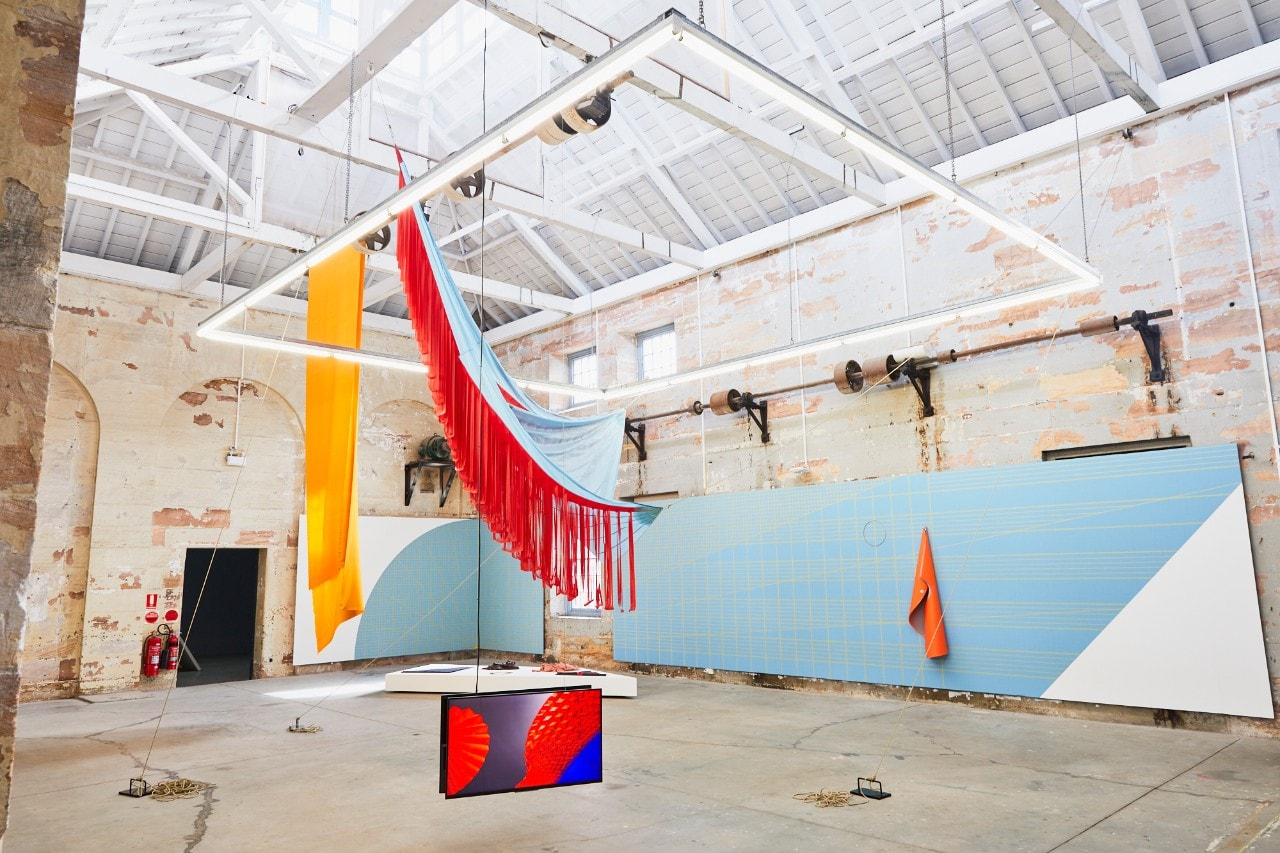 Art installation of cloth hanging from the gallery ceiling