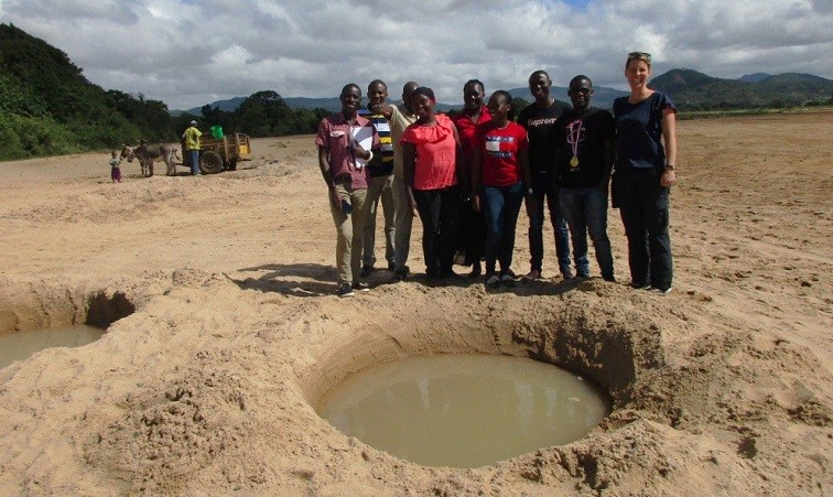 Dr Jacqueline Thomas and the WaSH team from Ifakara Health Institute viewing shallow open wells in Kondoa District in Tanzania