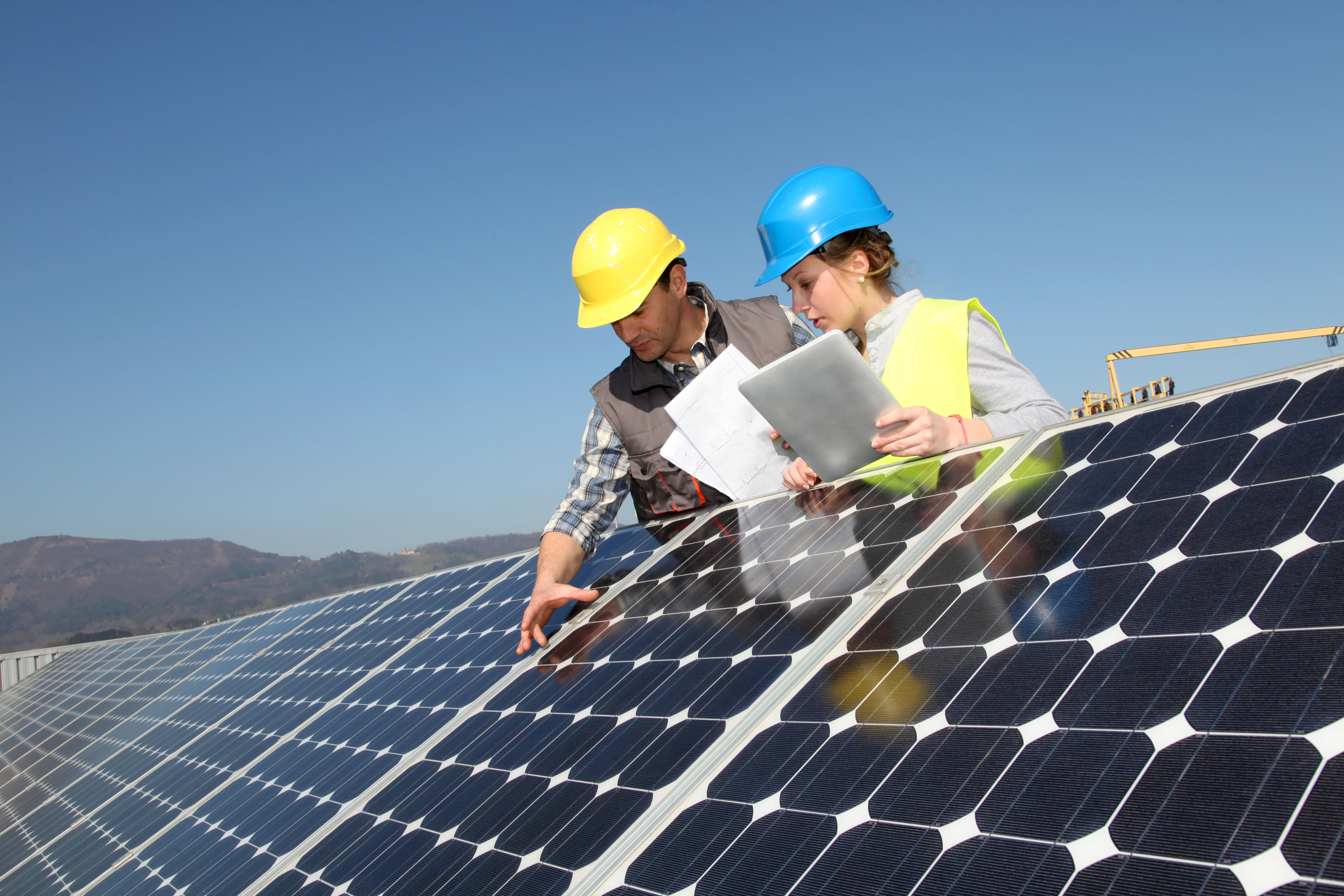 Engineers working on solar panels