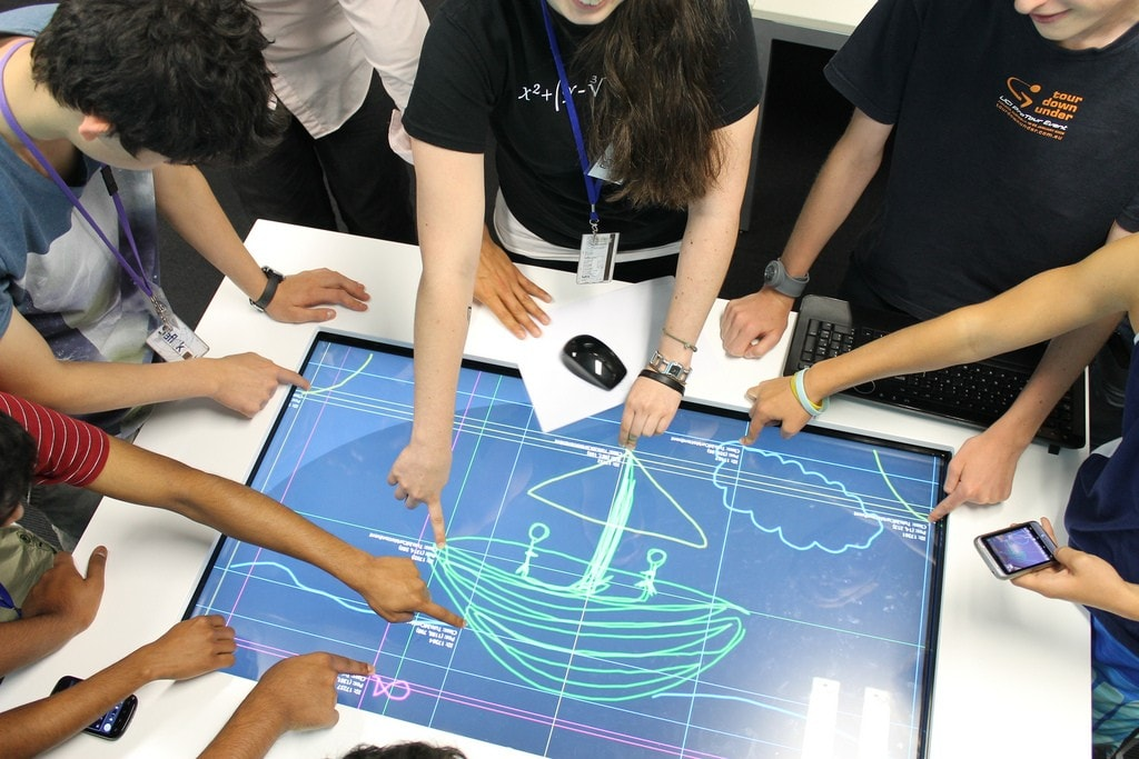 High school girls interacting with a touch screen table