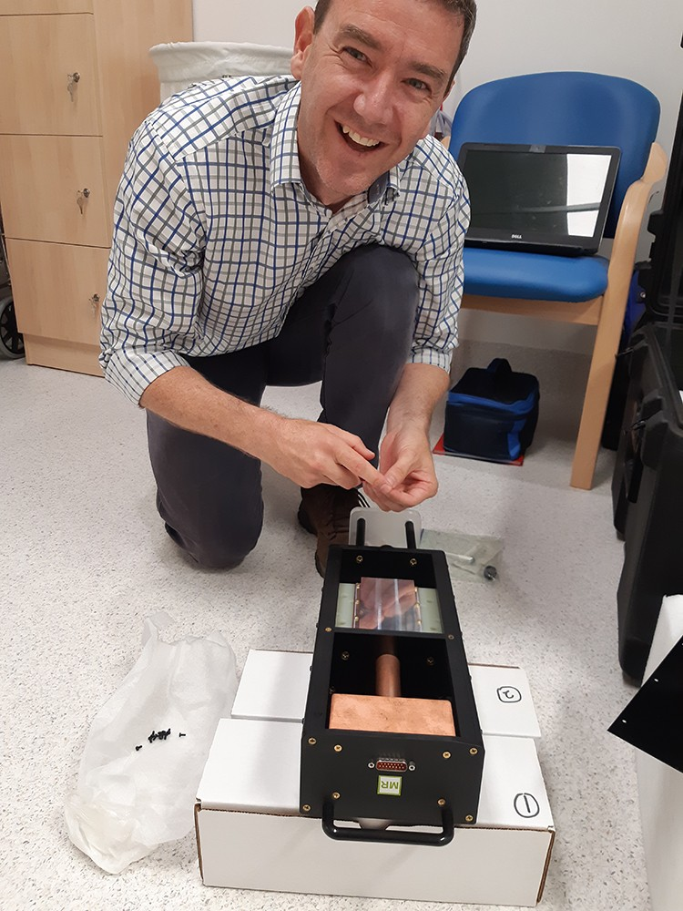 Graduate Terry Perkins at work on a medical physics device