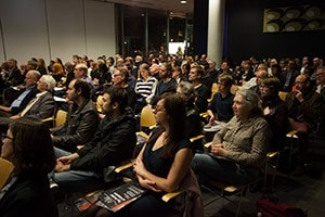 Image of people listening to a lecture