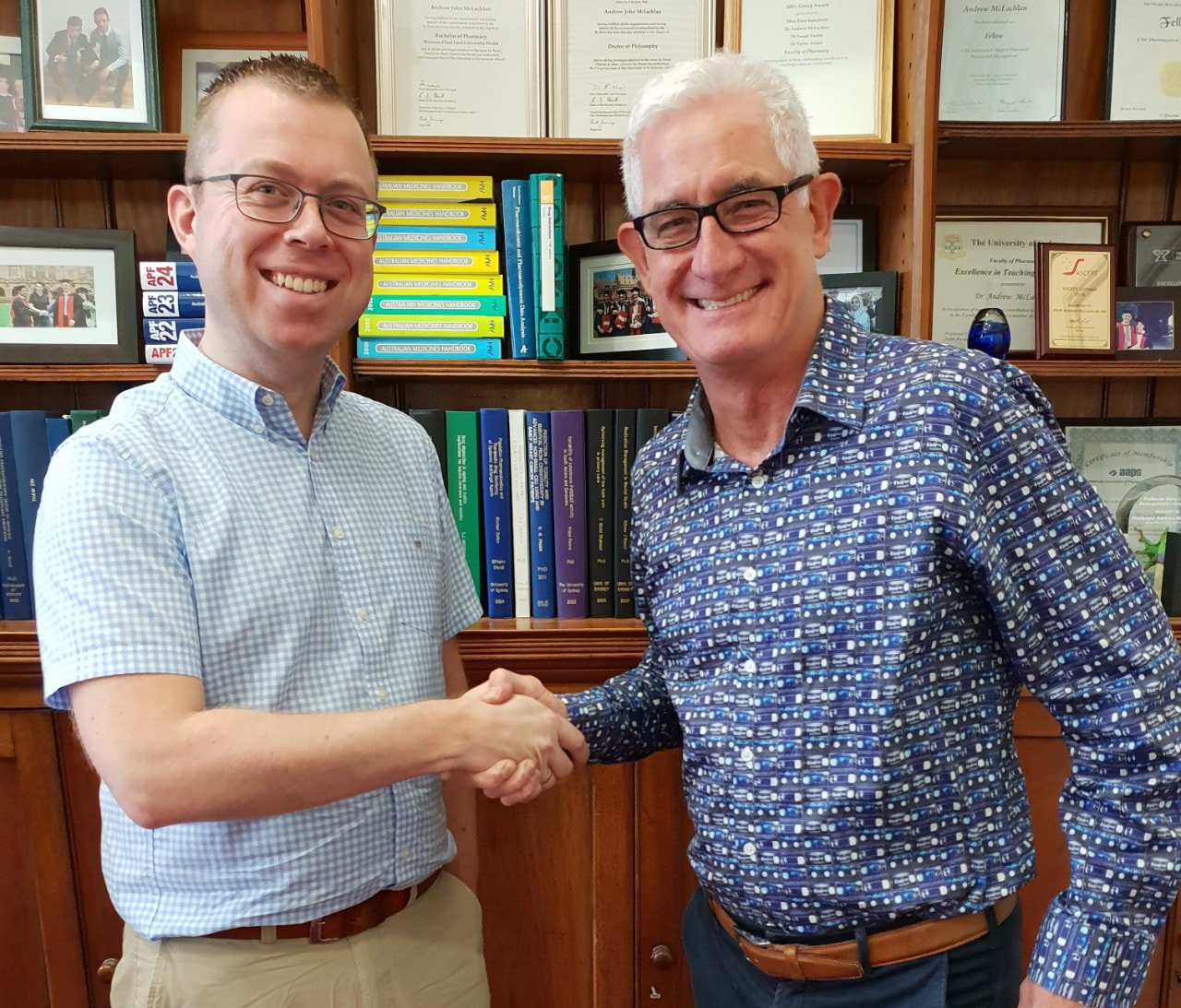 Professor Jan-Willem Alffenaar shaking hands with Professor Andrew McLachlan AM (R)