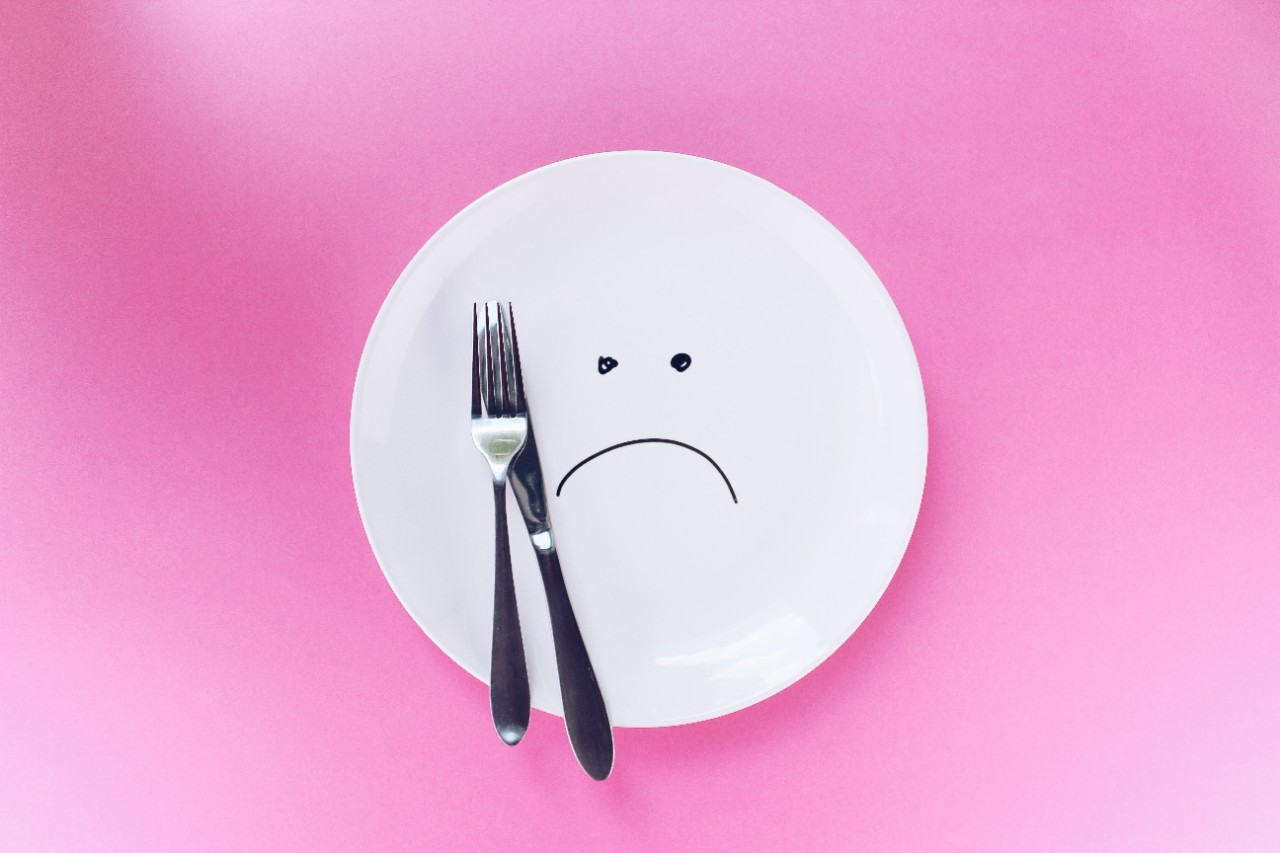 dinner plate with sad face