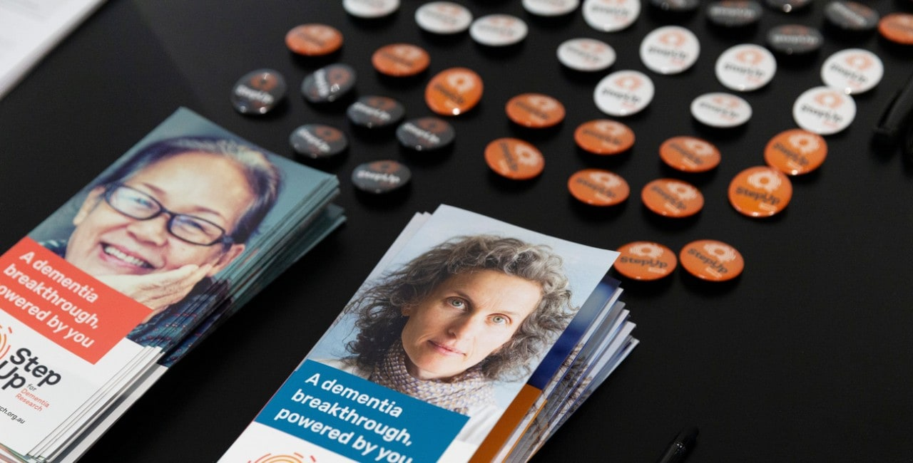 Step up for dementia promotional resources laid on table