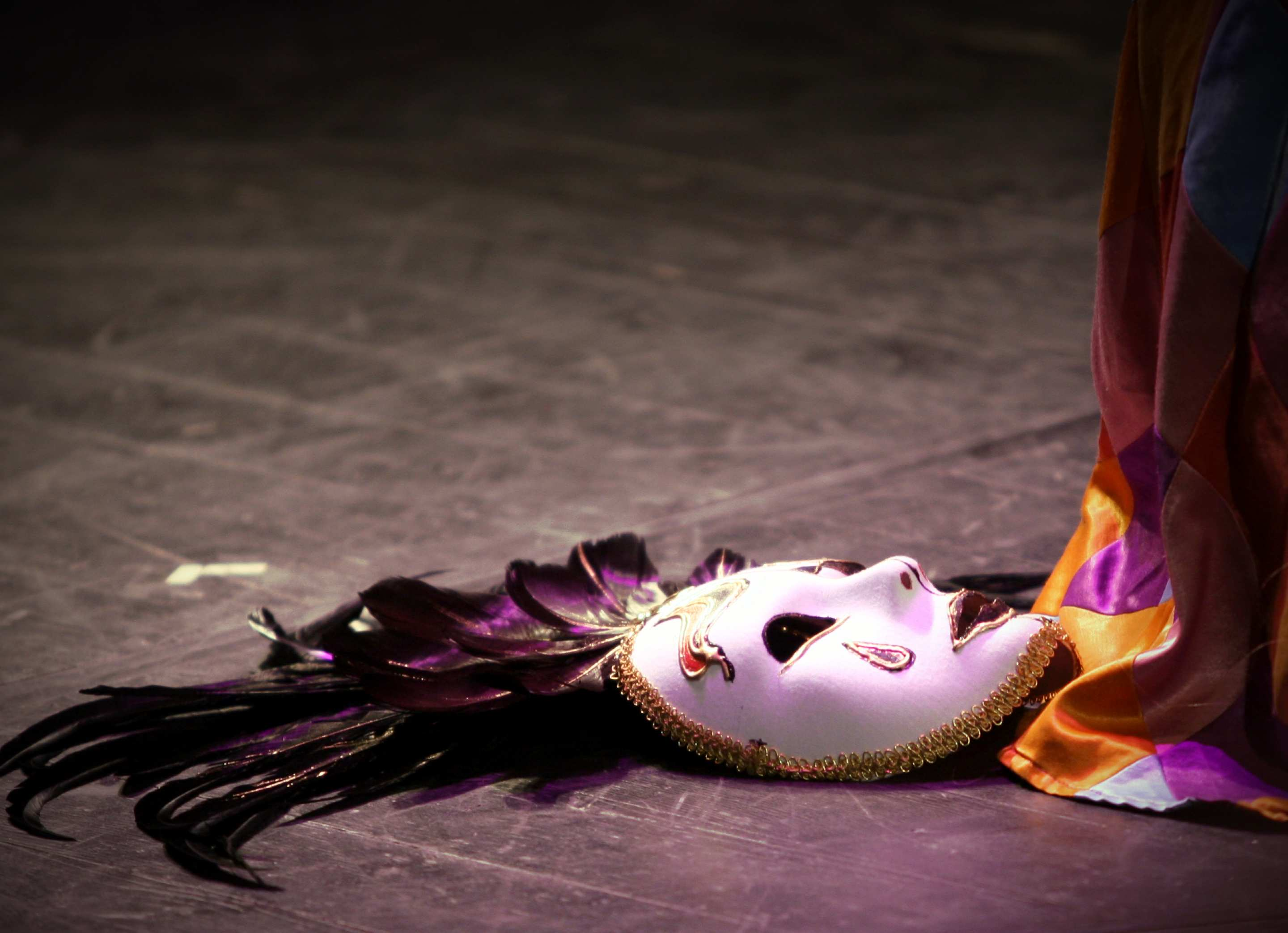 A stage performer's mask lies beside a stage curtain. Image: freeimages.com