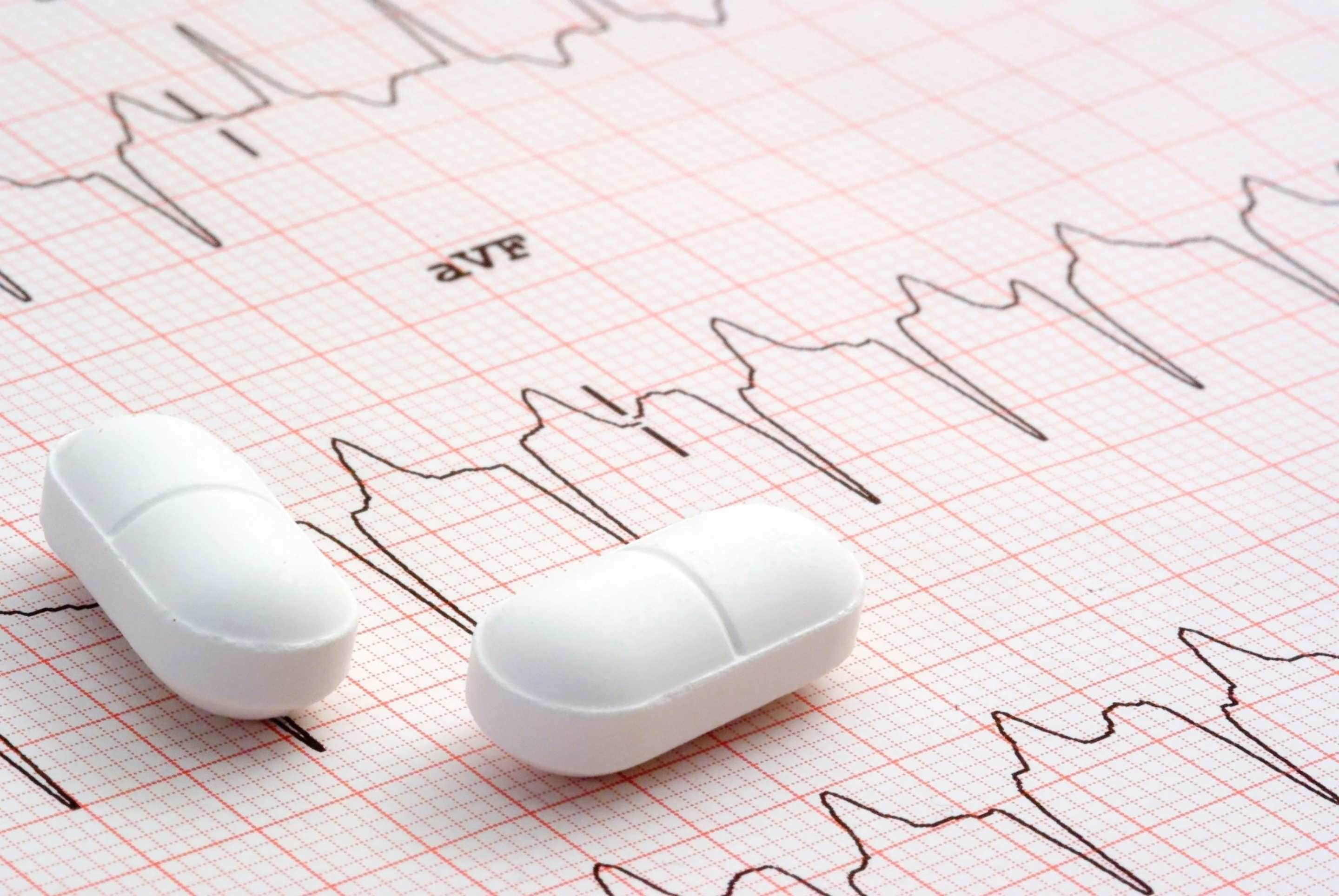 Image of cardiology graph and pharmaceutical pills