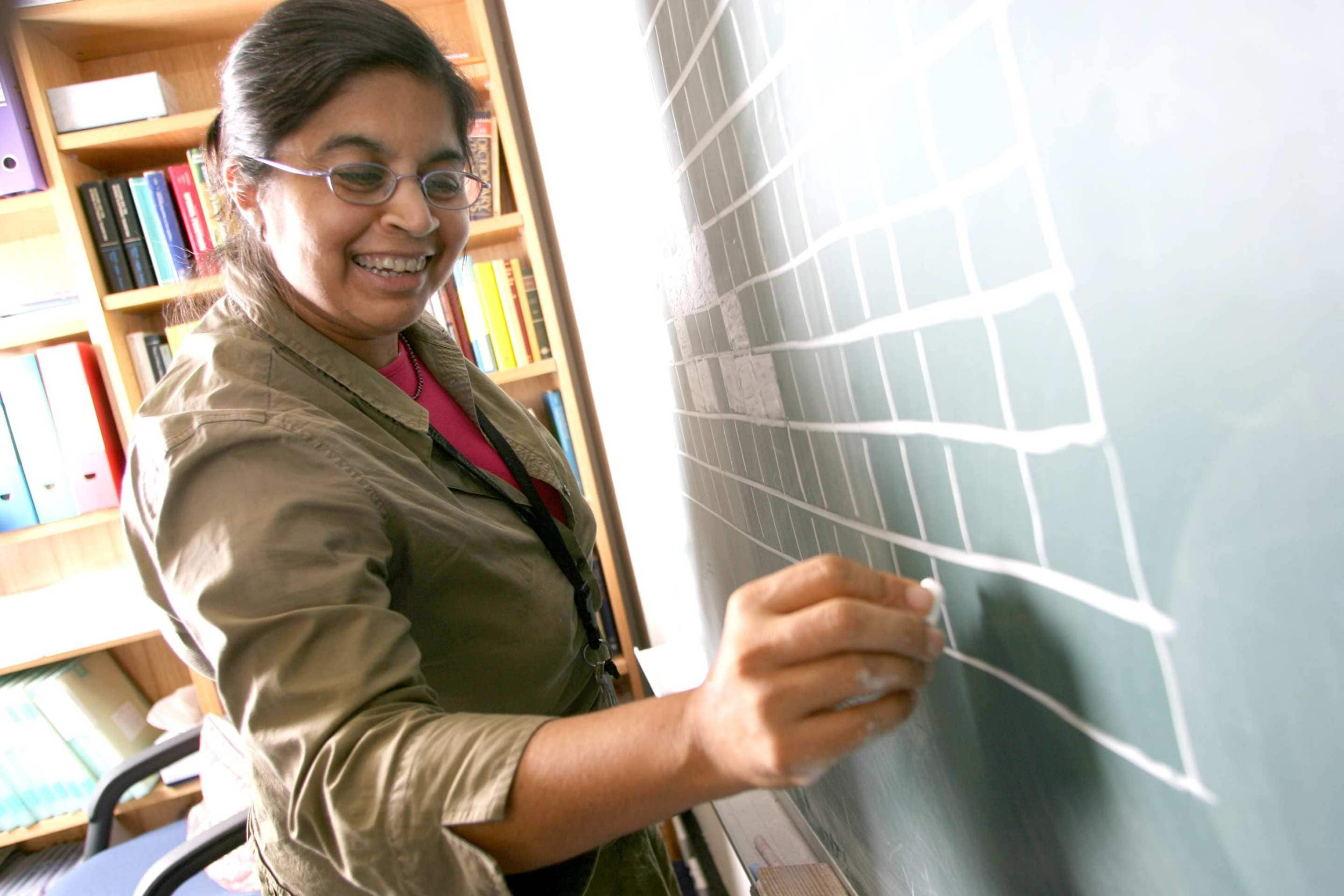Nalini Joshi uses a blackboard