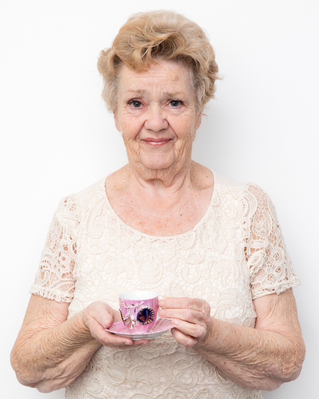 Treasured Possessions participant Maureen Lyndon holds an ornate pink tea cup. Image: Jason Cole