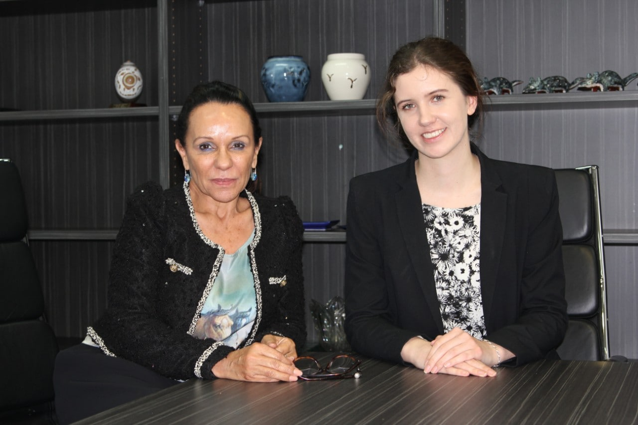 Federal politician Linda Burney poses for a photo with a student