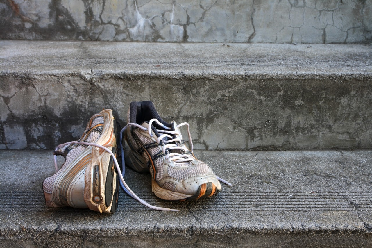 Old running shoes on the steps.