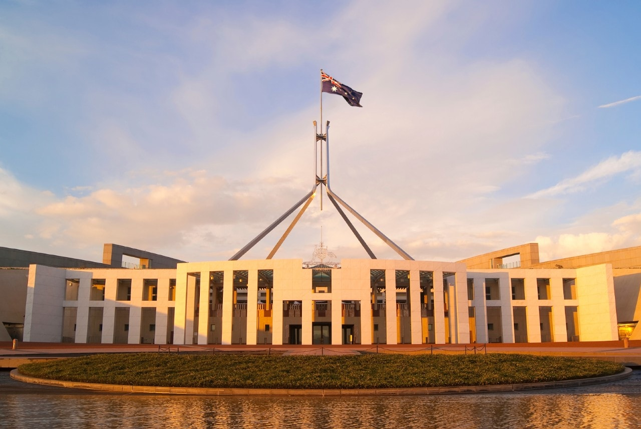 Parliament House in Canberra, Australia, at sunset.