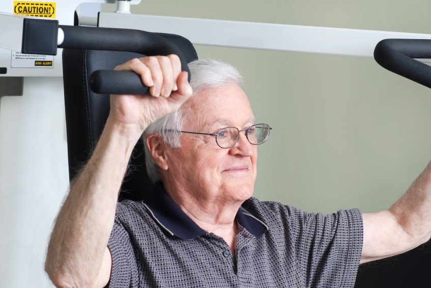 Older person doing weight training