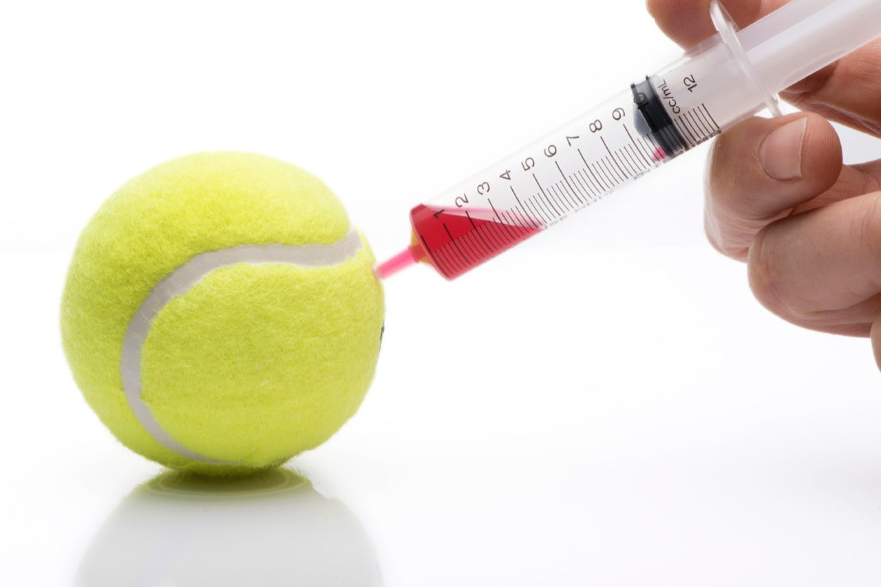Tennis ball bring injected with needle