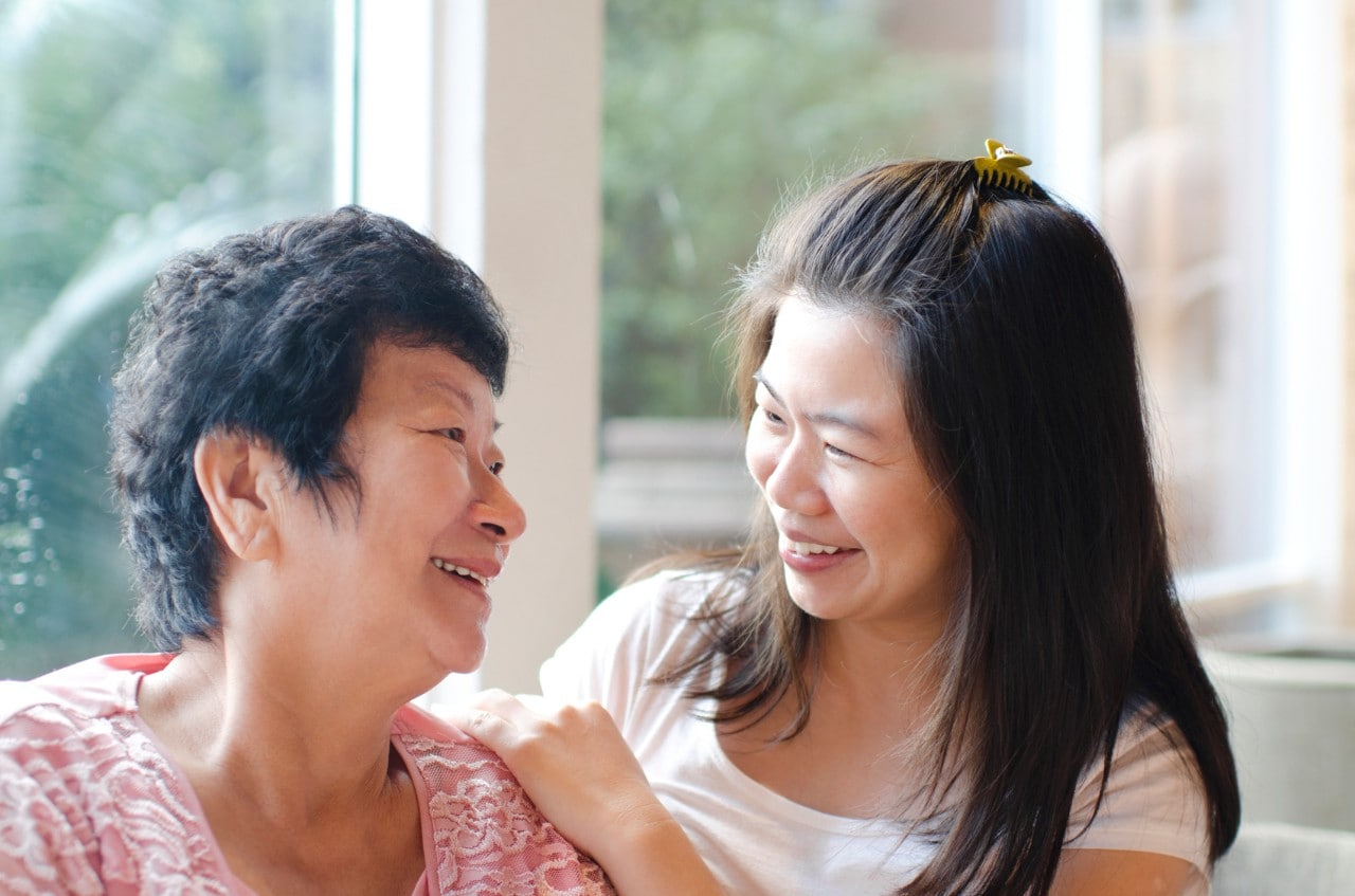 A stock image photograph of a mother and daughter in an embrace.