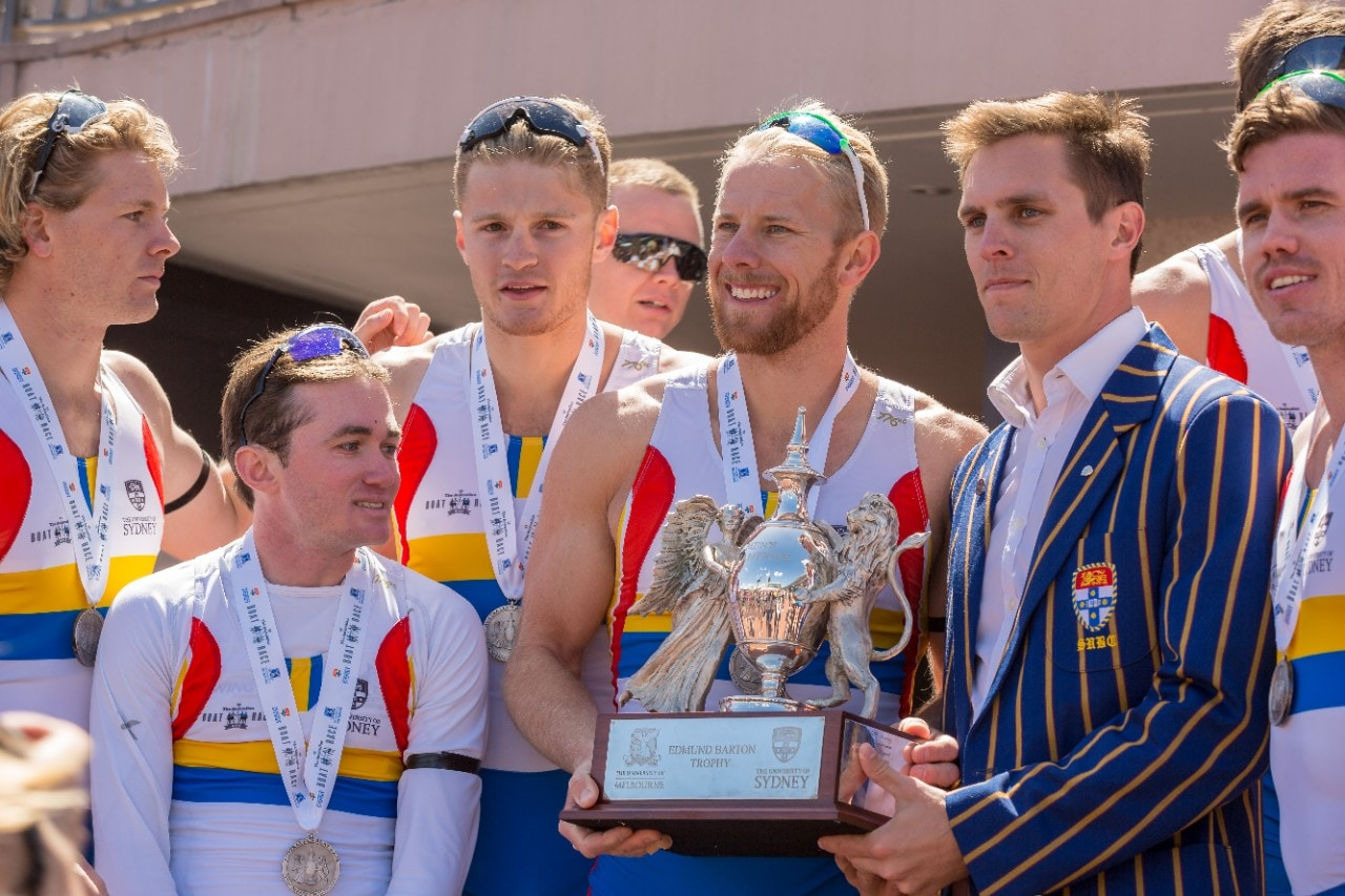 A photo of the Sydney men's crew with the Edmond Barton tropy