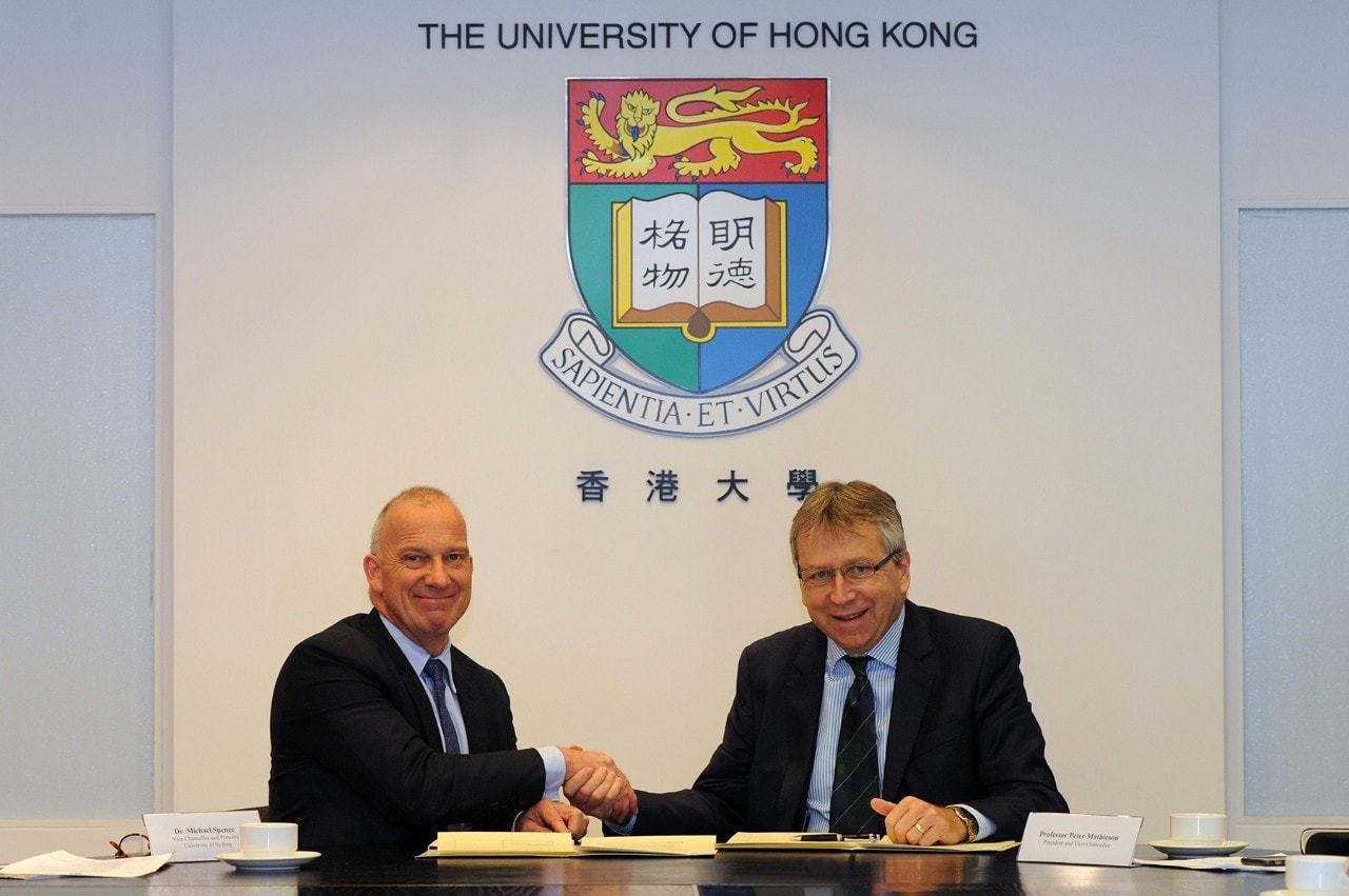 University of Sydney Vice-Chancellor and Principal Dr Michael Spence (left) and HKU President Professor Peter Mathieson sign the agreement.