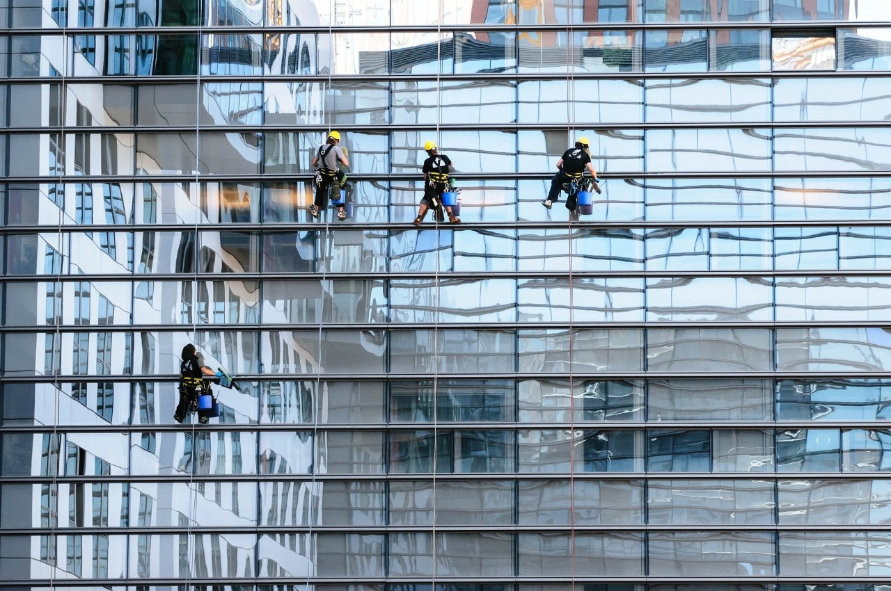 Window cleaners working on the exterior office window.