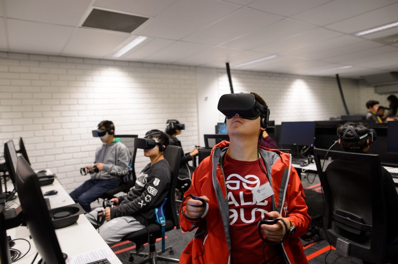 A student using an Oculus Rift headset in the new Immersive Learning Laboratory.