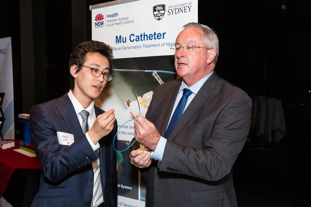 Dr Pierre Qian shows the Mu Catheter device to NSW Health Minister Brad Hazzard.