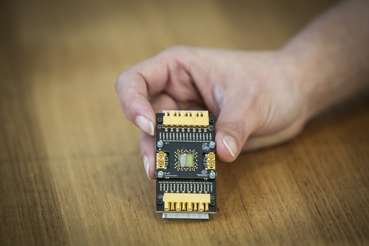 A semiconductor qubit device mounted on a custom cryogenic printed circuit board. Photo: Jayne Ion