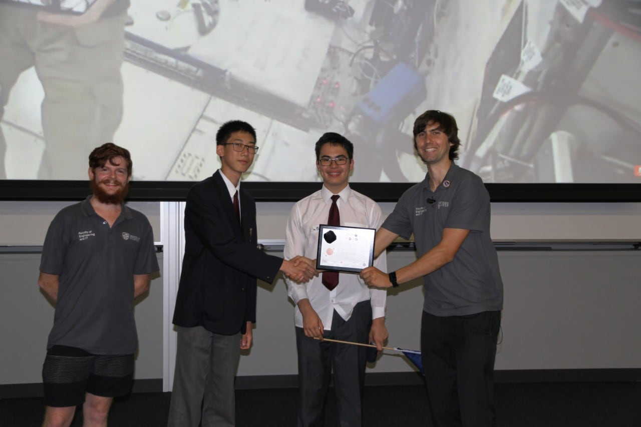 North Sydney Boys students with their mentor and Zero Robotics Coordinator Benjamin Morrell during plaque ceremony