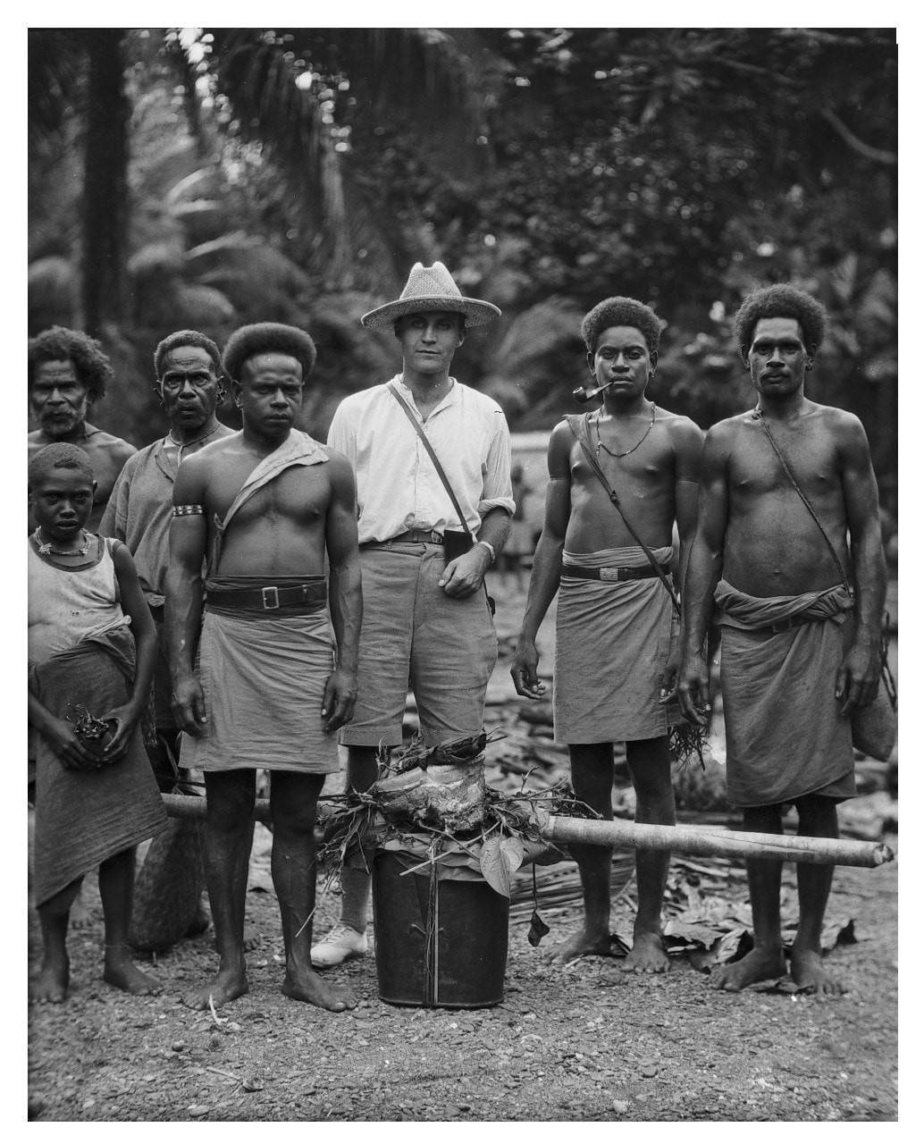 A photo of anthropologist Ian Hogbin and research assistants in Guadalcanal, Solomon Islands, 1930s.