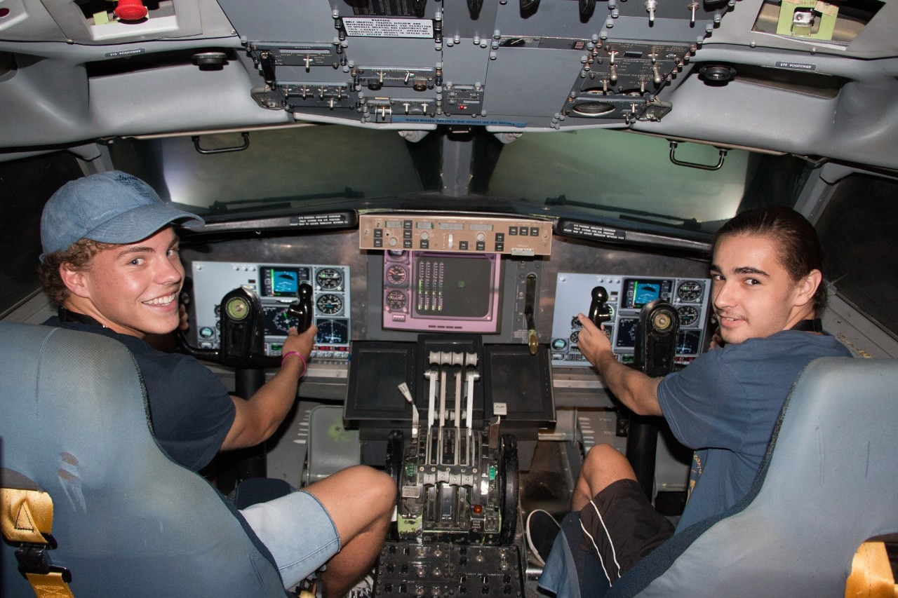 A photo of students in the flight simulator.
