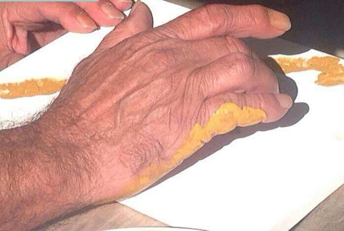 A hand of an Aboriginal and Torres Strait Island man