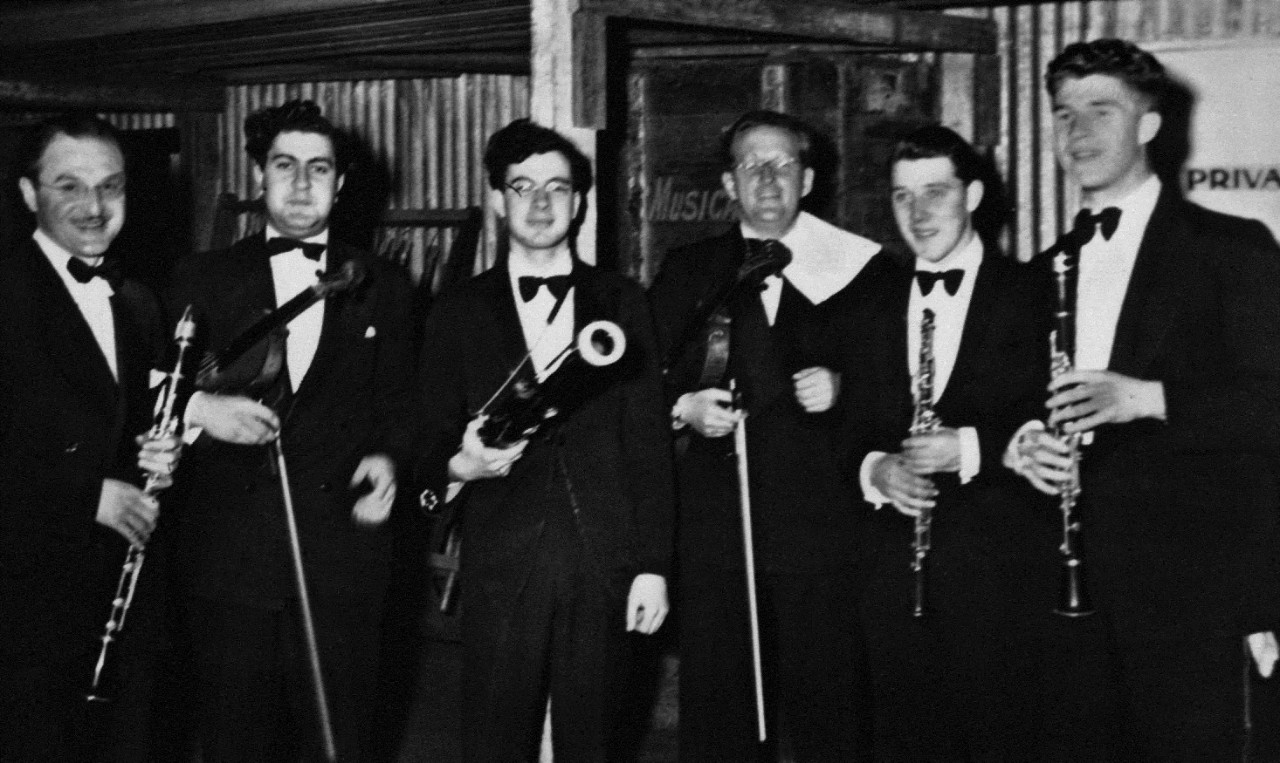 George Dreyfus, centre, holding a bassoon and Walter Wurzburger, far left, holding a clarinet. JC Williamson production 1949