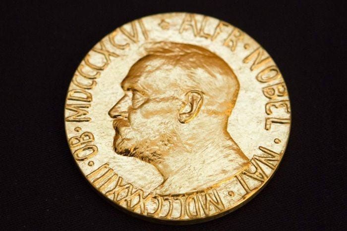 A gold Nobel Prize medallion