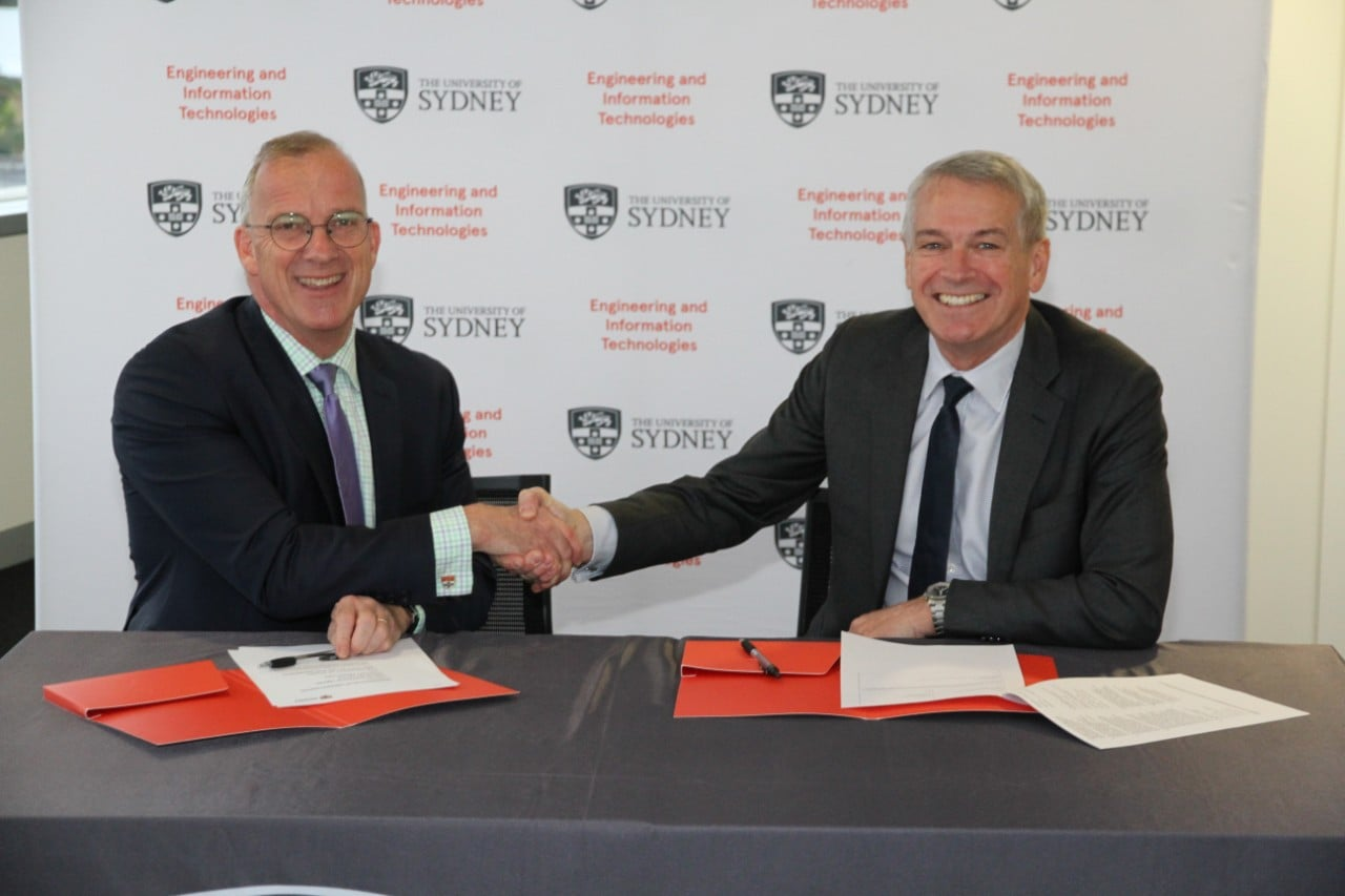 University of Sydney Vice-Chancellor and Principal Dr Michael Spence and Thales Australia Country Director and CEO Chris Jenkins sign the MOU agreement.