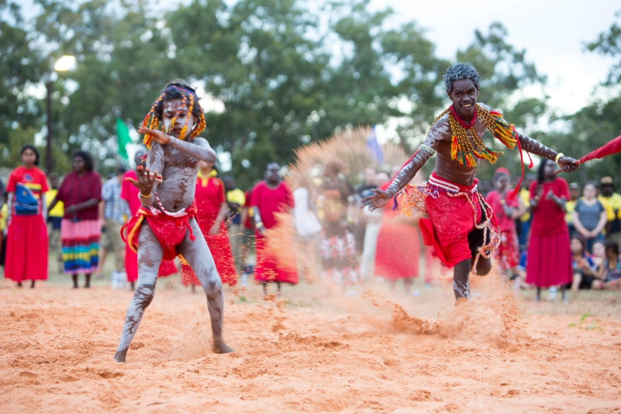 A photo of young Aboriginal people dancing in traditional dress.