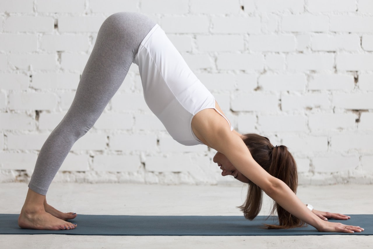 "Image of a person practising the ""downward-facing dog"" yoga pose."