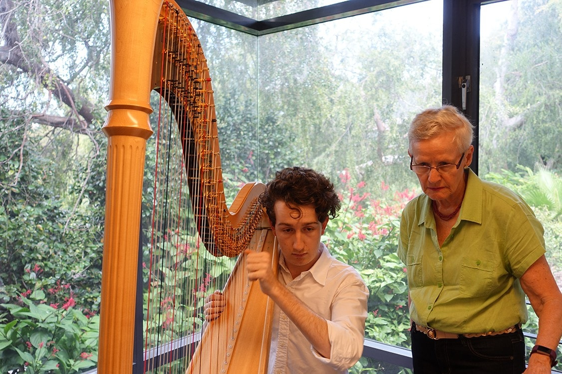 Will Nichols harpist runs through his solo part with Anne Boyd