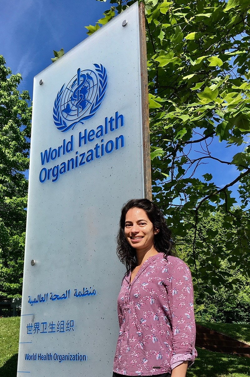 Anna Dean standing in front of the World Health Organization in Geneva