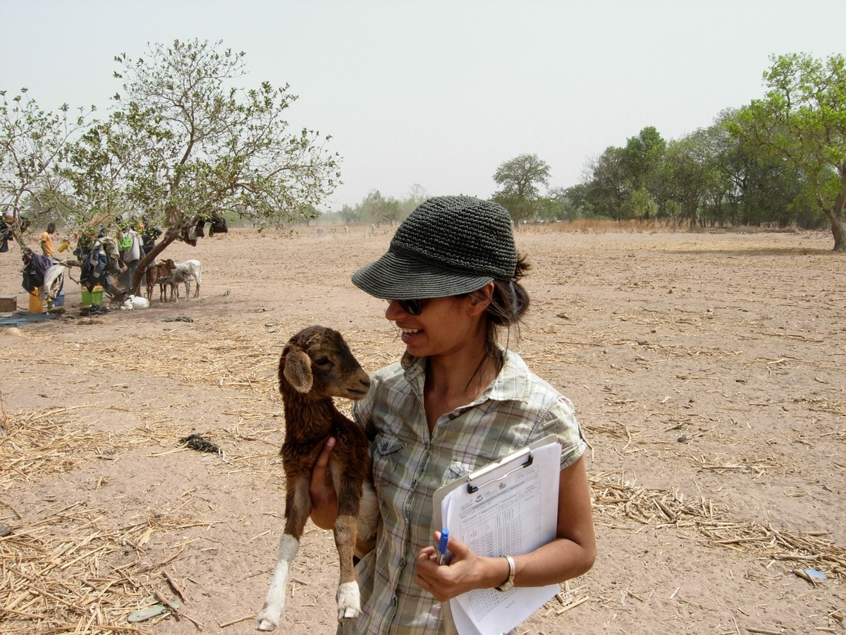 Anna Dean with a baby goat in a rural community in Togo, West Africa