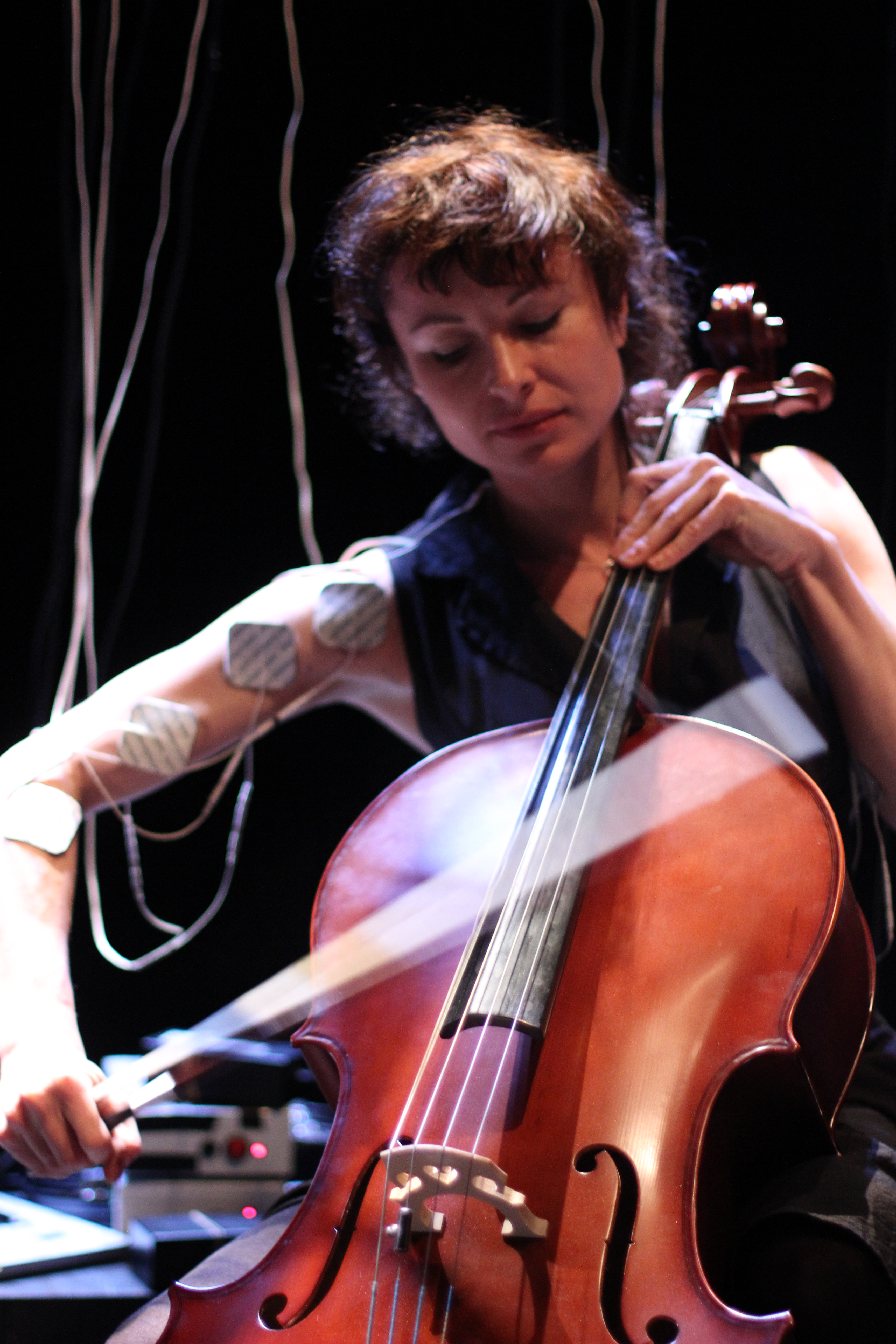 Michaela Davies' performance on a double bass is driven by electric muscle stimulation producing involuntary music.