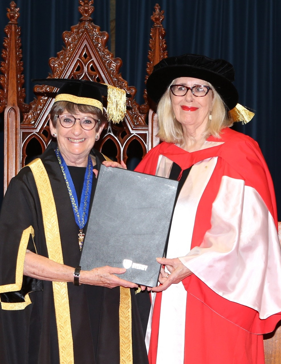 Pro-Chancellor, Mrs Dorothy Hoddinott AO presents a Doctor of Letters (honoris causa) to Dr Anne Summers Ao.