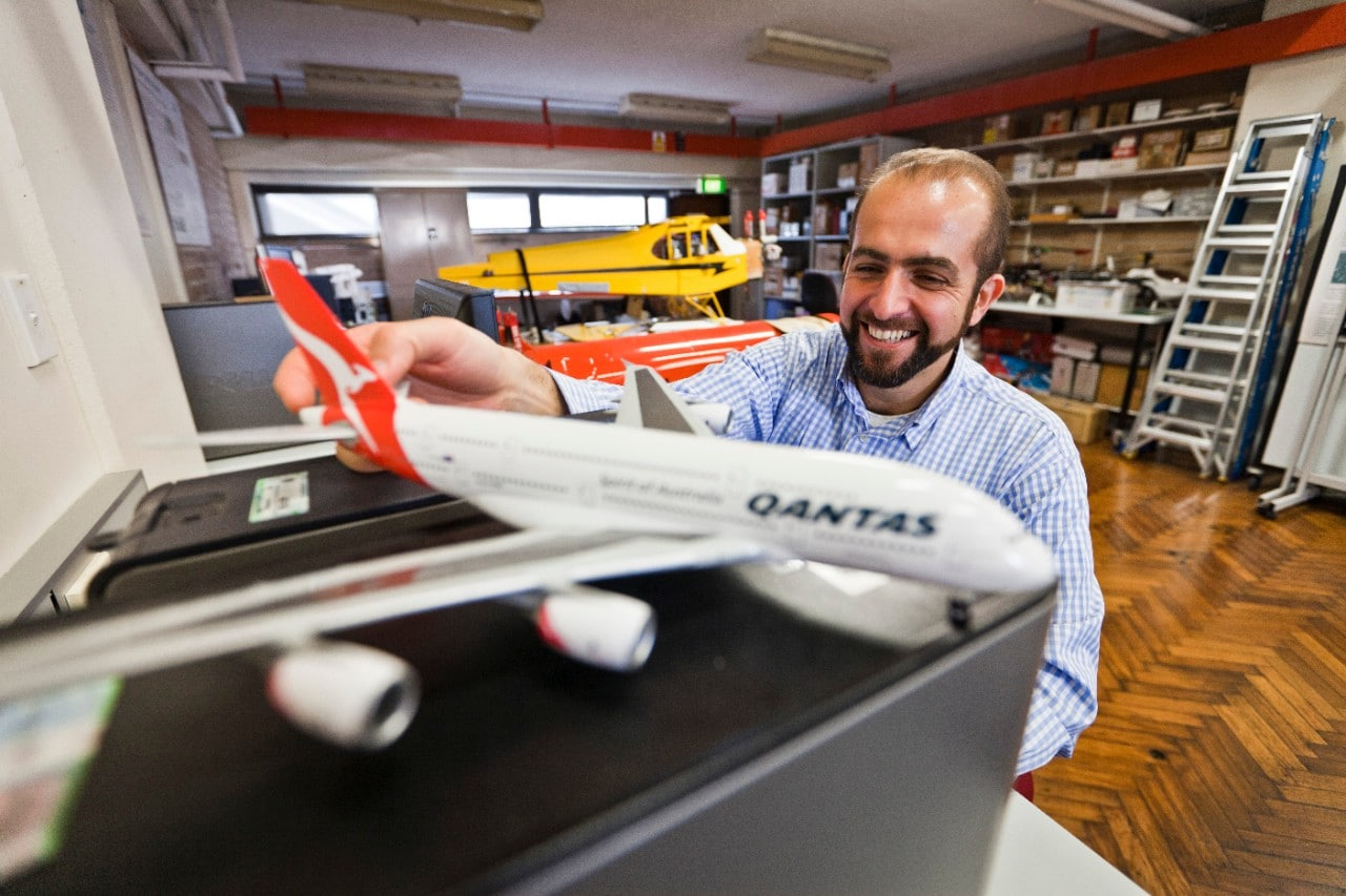 Professor Salah Sukkarieh with a model of a Qantas plane.