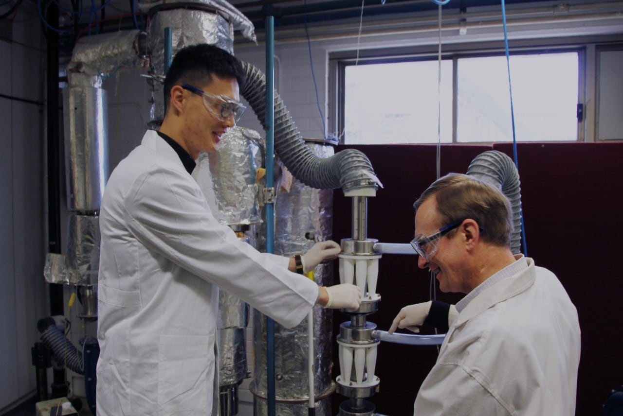 Professor Timothy Langrish and PhD candidate Harry Huang work on the new spray dryer.
